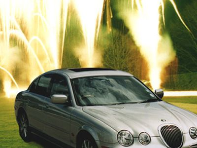 Launch of Jaguar X-Type with fireworks in background