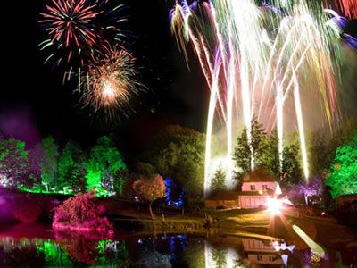 Wide angle shot of garden with fireworks and lighting